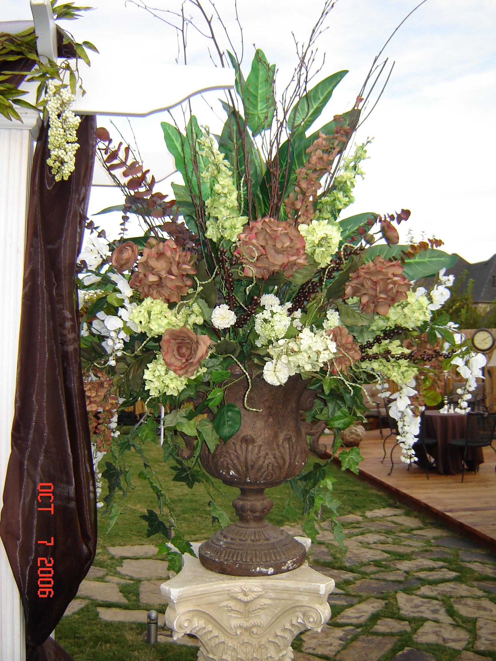 Simply elegant weddings flower arrangements in brown urn izmirmasajfo