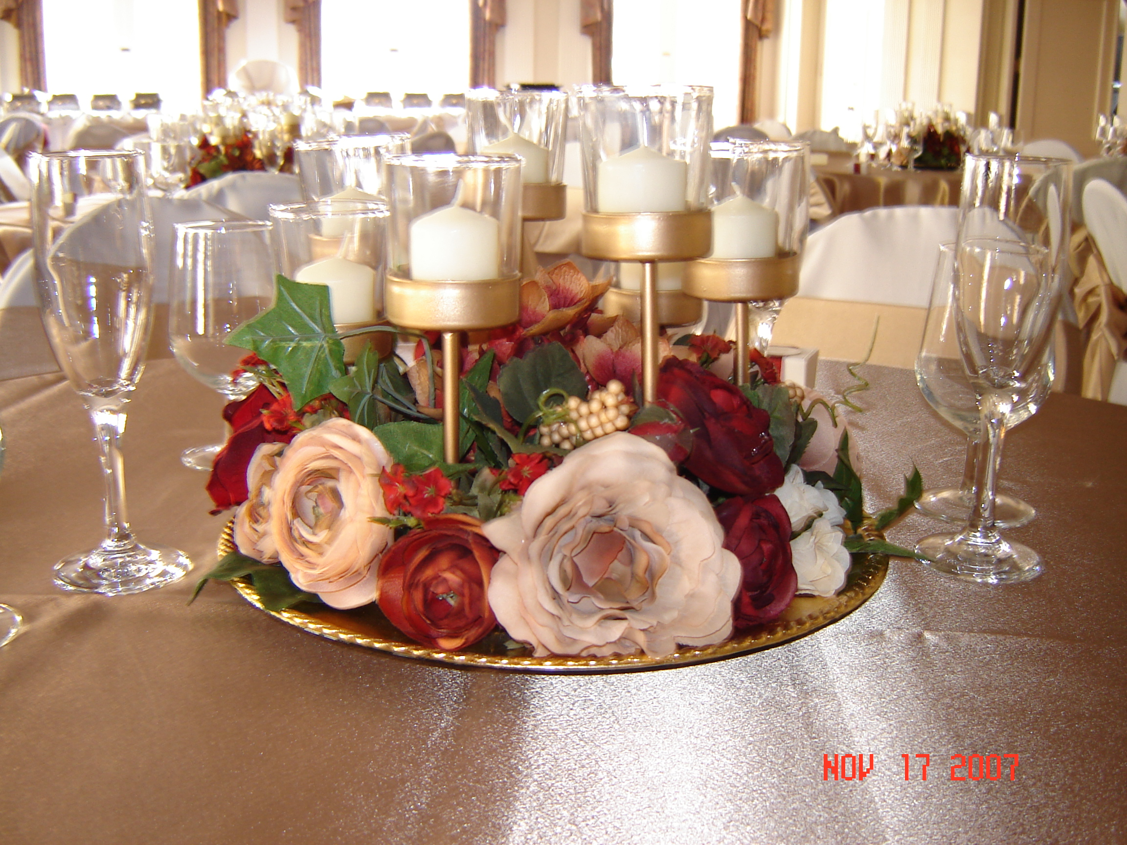 Simply Elegant Weddings- Flower Arrangements on flower table runner, flower chair covers, flower ball rentals, lighting rentals,